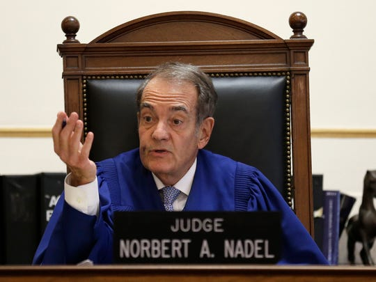 FILE - In this Wednesday, June 25, 2014 file photo, Judge Norbert Nadel listens to arguments at a hearing for Judge Tracie Hunter in Hamilton County Common Pleas Court in Cincinnati. Nadel, a county judge in Cincinnati who ruled in favor of Pete Rose during the Reds star's court fight against Major League Baseball and recently ordered a fellow judge to jail, is retiring after four decades on the bench. (AP Photo/Al Behrman, File)