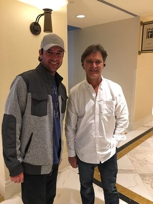 Bubba Watson with Miami Marlins manager Don Mattingly, the former New York Yankees star slugger, in a meeting at the hotel where the Baseball Winter Meetings were being held outside of Washington, D.C..