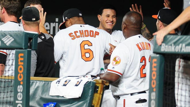 Manny Machado and Jonathan Schoop celebrate in the dugout after turning a triple play in the Orioles' 7-5 loss to Detroit on Thursday.
