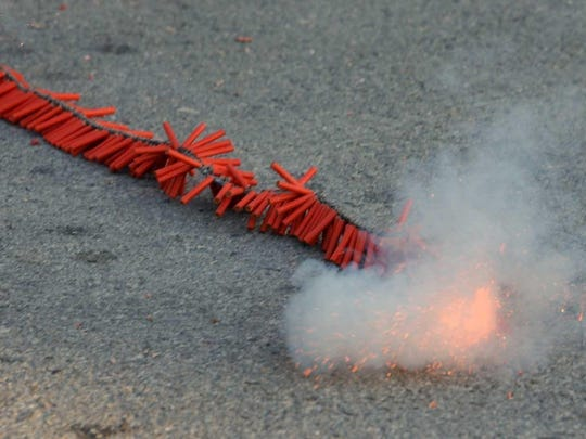 A string of firecrackers explodes.