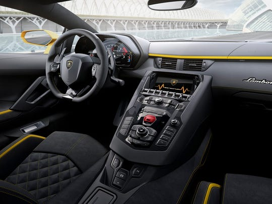 The 2017 Lamborghini Aventador S has an airplane-like cockpit, tucked inside an all-carbon-fiber monocoque shell, that brings everything within easy reach of the pilot. (Lamborghini)