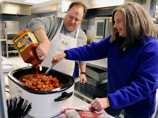 Christ United Methodist Church Finance and Office Manager Mike Deweese and church member Betty White prepare dinner for Room In The Inn guests at the church in Franklin.