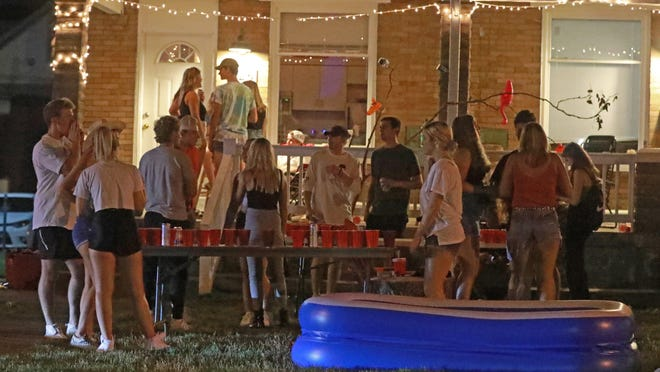 Off-campus porch and yard parties near the Ohio State University campus in Columbus were packed Thursday, August 20, 2020. Few masks were visible despite the continuing COVID-19 pandemic. A mix of online and in-person classes begins August 25, 2020, at the Columbus campus.