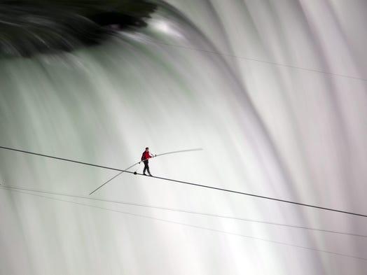Nik Wallenda walks over Niagara Falls on a tightrope in Niagara Falls, Ontario, on Friday, June 15, 2012.