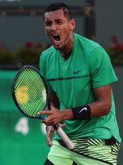 Nick Kyrgios, of Australia, reacts to his win over