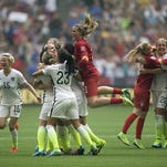 United States players celebrate after they defeated Japan 5-2 in the FIFA Women's World Cup soccer championship in Vancouver, British Columbia, Canada, Sunday, July 5, 2015. (Darryl Dyck/The Canadian Press via AP) MANDATORY CREDIT