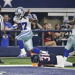 Dallas Cowboys running back Gus Johnson (37) scores over Houston Texans defensive back Charles James (31) during the second half of Thursday's preseason game.