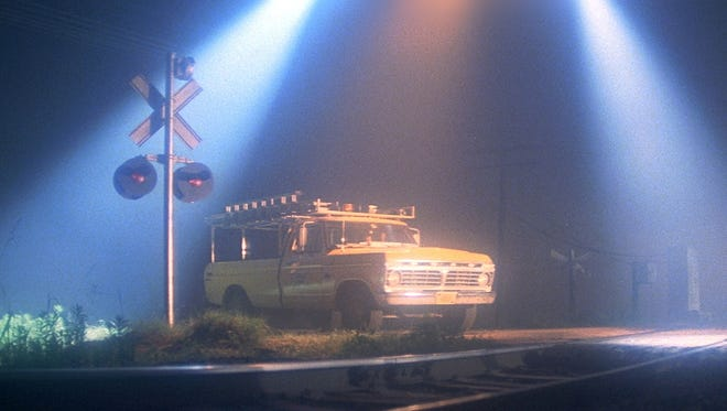"While investigating a series of power-outages, Richard Dreyfuss, who portrayed an Indiana electrical lineman, is stuck on a train track in the movie ""Close Encounters of the Third Kind""."