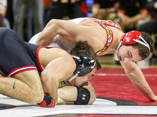 Rutgers' Richie Lewis (left), shown wrestling Maryland's Lou Mascola on Jan. 29, recorded a big win over Michgah's Brian Murphy on Sunday