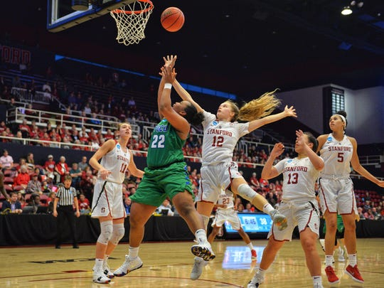 Florida Gulf Coast University's China Dow drives to the hoop during the second round against the Stanford Cardinal in the NCAA women's basketball tournament at Maples Pavilion at Stanford University on Monday. The Eagles lost, 90-70.
