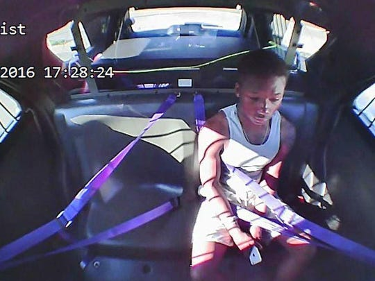This is a photo of police video showing Bryson White sitting in the backseat of a Mason police cruiser after being arrested and charged with OVI on March 18.