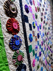 A detail of Joyce Hewitt's Yo Yo's Galore quilt owned by Pam Griffith at the Breckenridge Fine Arts Center. The machine-made creation is part of the 2018 Quilt Show, on display at the BFAC through Friday.