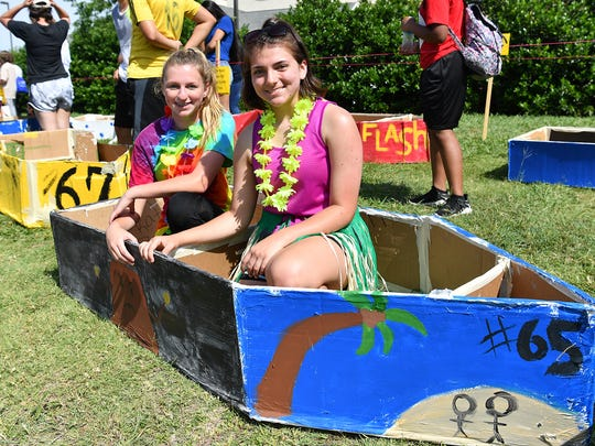 Sidney Bailey, left, and Sarenna Guess in their Hawaiian-themed boat as they wait to participate in the 12th Annual Barwise Cardboard Boat Float at Sikes Lake.