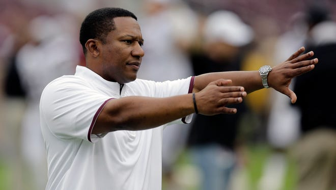 Texas A&M secondary coach Terry Joseph directs his players before an NCAA college football game against South Carolina, Saturday, Oct. 31, 2015, in College Station, Texas.