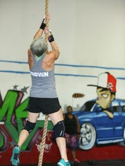 Karin Gogolsky does a legless rope climb. Gogolsky has been doing Crossfit for five years, all of it at CrossFit Taproot.