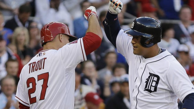Miguel Cabrera of the Detroit Tigers, right, celebrates with Mike Trout of the Los Angeles Angels after hitting a home run during the MLB All-Star Game on July 15, 2014, in Minneapolis.