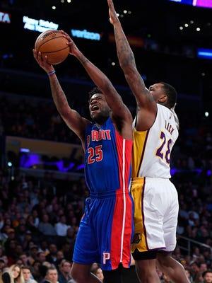 Detroit Pistons forward Reggie Bullock gets past Los Angeles Lakers center Tarik Black during the first half Sunday night.