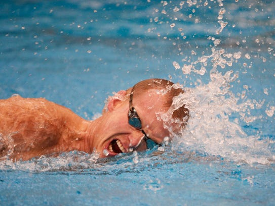 Chris Doemland swims laps at Central York High School.