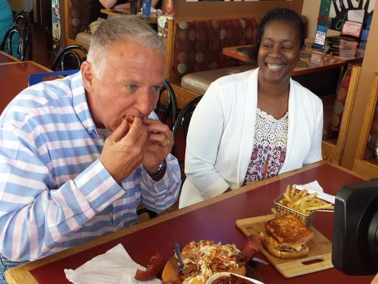 John McGivern, left, has a bite to eat at Cozzy Corner with owner Natasha Banks in June.