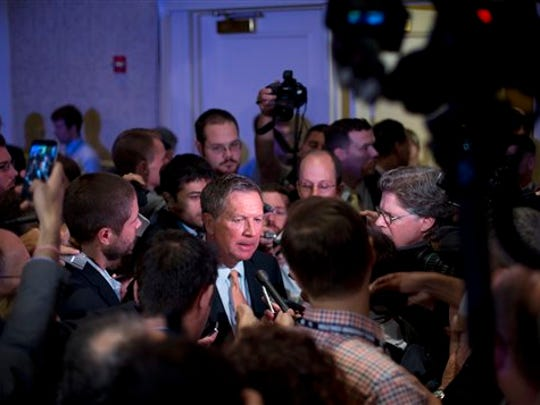 Ohio Gov. John Kasich answers questions for members of the media after speaking at the Road to Majority 2015 convention in Washington, Friday, June 19, 2015.