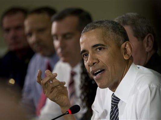 636040384134143290-Obama-meeting.jpg