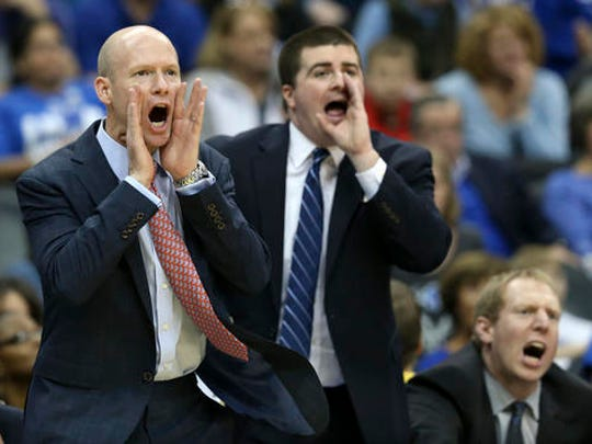 Acting Saint Peter's head coach Ryan Whalen (center) pictured on Kevin Willard's staff at Seton Hall.