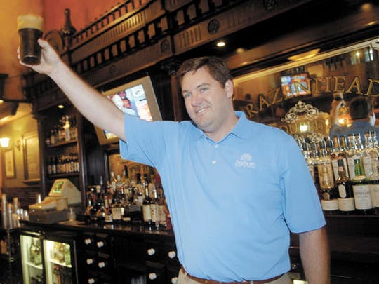 In this Aug. 1, 2008 photo, Dublin Irish Festival honorary chairman John T. Fleming proposes at toast following the tapping of the first Dublin Stout Keg at Brazenhead in Dublin, Ohio. A flight-tracking service shows that a plane piloted by the Ohio executive with five other people onboard quickly lost altitude after taking off from Cleveland's lakeshore airport. The parents of Superior Beverage Company executive John T. Fleming confirmed he was piloting the Columbus-bound plane when it vanished late Thursday, Dec. 29, 2016, over Lake Erie.