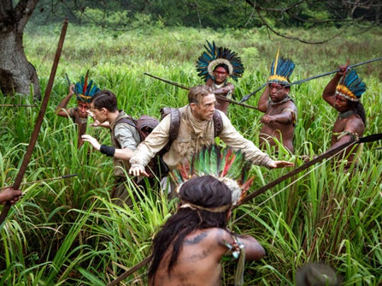"This image released by Amazon Studios/Bleecker Street Films shows Tom Holland, center left, and Charlie Hunnam, center left, in a scene from ""The Lost City of Z."""