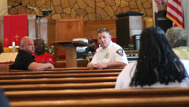 Sheriff Kyle Overmyer and Fremont Police Chief Dean Bliss hear concerns from residents during a town hall discussion Saturday.