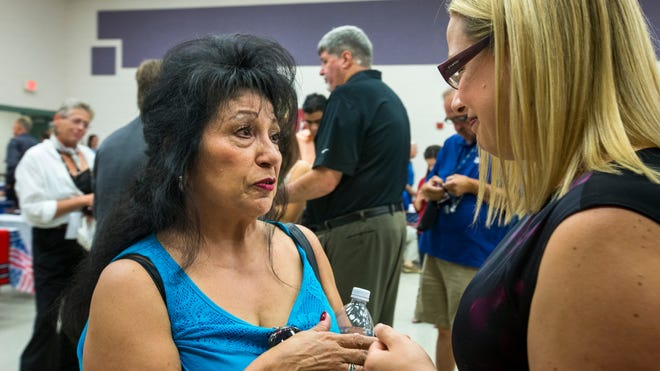 Rosemarie Preece (left) talks with U.S. Rep. Kyrsten Sinema at the fair. Preece had sought benefits from the VA related to her husband's service in Vietnam for many years.<137>First: Health care, benefits and resource clinic at the Montecito Community School in Phoenix, on Tuesday, July 1, 2014. Preece's husband was a Vietnam vet who was exposed to Agent Orange, and died years ago. She is seeking eligibility for her daughters who now have cancer.