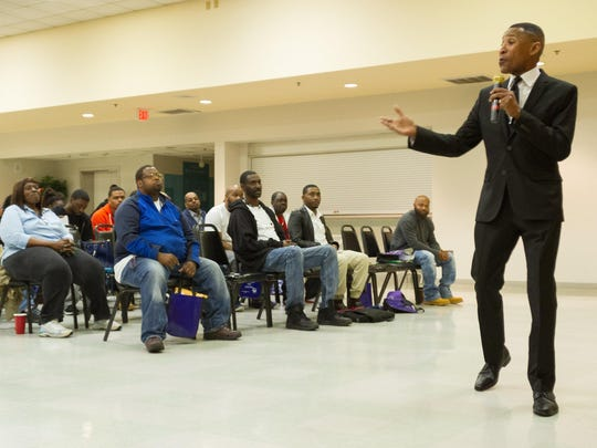 A crowd attends a pardon and expungement clinic held by Pastor Derrick Johnson. Lawyers volunteer Saturday to advise Wilmington residents on cleaning up their records.