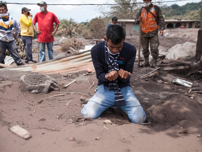 Bryan Rivera cries after looking at the remains of
