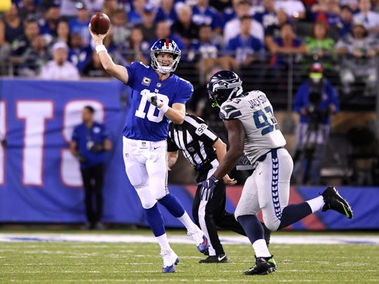 New York Giants quarterback Eli Manning (10) gets rid of the ball with pressure from Seattle Seahawks defensive tackle Nazair Jones (92). The Seattle Seahawks defeat the New York Giants 24-7 on Sunday, October 22, 2017 in East Rutherford, NJ.