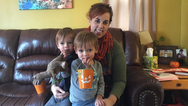 Alysun Ogilby with her 2 1/2-year-old twin sons, Declan and Everett, at their Golf Manor Home on Friday. Ogilby started a gogetfunding account with $5 and has raised more than $1,000 for a newspaper hawker who rides his beat-up bike and pulls papers on a child cart pulled behind. The outpouring of financial giving has shocked Ogilby.