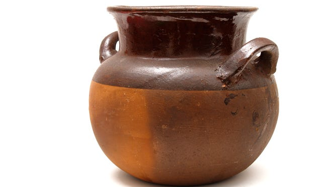 An olla is a pot, especially an earthen pot, for holding water, cooking, etc. It could be used to collect kitchen sink water for plants but take care that the water does not  contain harmful detergents or microbial particles.