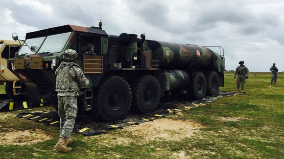 5) Soldiers from Fort Bliss' 2nd Battalion, 501st Aviation Regiment set up a forward arming and refueling point.