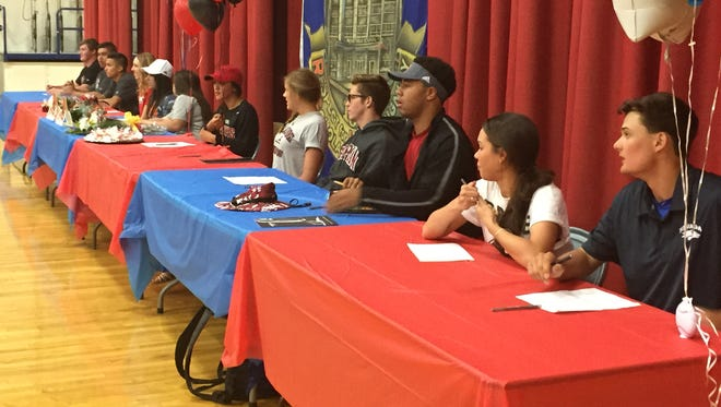 Reno High had 12 athletes sign their letters of intent for college on Tuesday at the school.