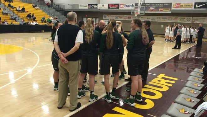 North Marion's girls basketball team falls to Banks.