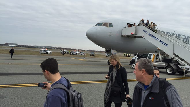 Passengers deplane from American Airlines flight 67 after it landed at John F. Kennedy International Airport in New York on Sunday. Authorities at the airport are investigating a bomb threat made to American Airlines Flight 67 from Barcelona that landed safely in New York City.