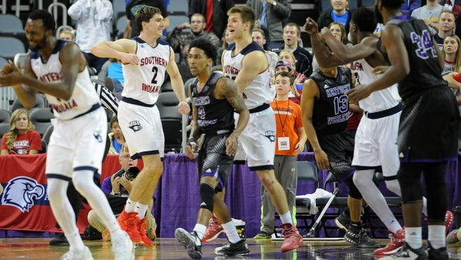 Southern Indiana forward Jacob Norman (2) celebrates with the team during the Small College Basketball Hall of Fame Classic against Kentucky Wesleyan at the Ford Center in Evansville, Saturday, Nov. 19, 2016. Southern Indiana beat Kentucky Wesleyan 85-81.
