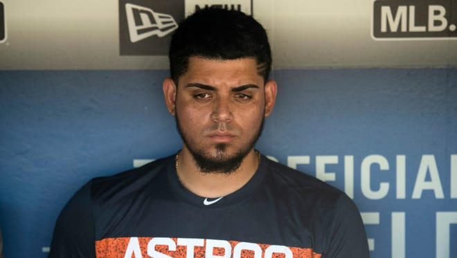 Houston Astros relief pitcher Roberto Osuna is interviewed in the dugout before a game against the Los Angeles Dodgers on Sunday.