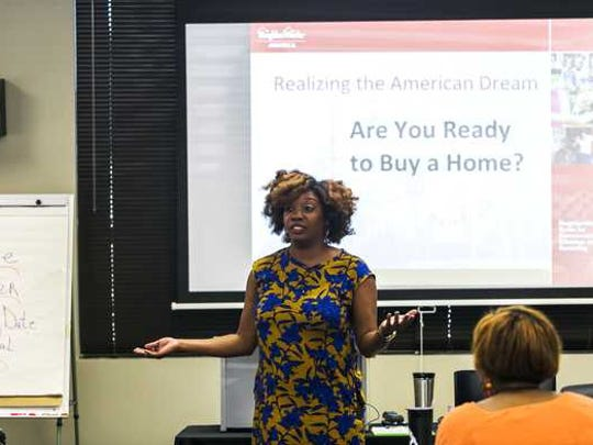 Kendra Love teaches during a homebuyer education class at United Housing in 2016.