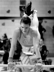 Whitefish Bay's Jess Fetting competes on the uneven