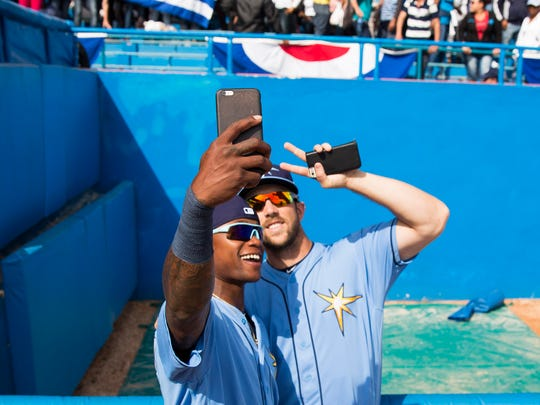 Tampa Bay Rays right fielder Steven Souza Jr. (20) and second baseman Tim Beckham (1) take a selfie in front of the crowd before a baseball game between the Rays and the Cuban national team in Havana, Cuba, Tuesday, March 22, 2016. It's the first game featuring an MLB team in Cuba since the Baltimore Orioles played in the country in 1999.  (Will Vragovic/The Tampa Bay Times via AP)  TAMPA OUT; CITRUS COUNTY OUT; PORT CHARLOTTE OUT; BROOKSVILLE HERNANDO TODAY OUT; MANDATORY CREDIT