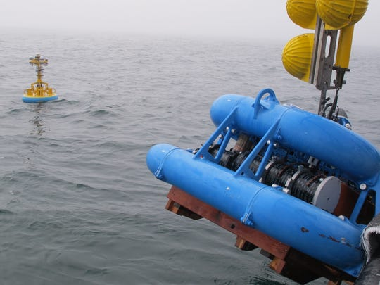The Endurance Washington Inshore Surface Mooring, which contains seafloor and surface instruments and communications equipment, being deployed off Grays Harbor, Washington, in 2014.