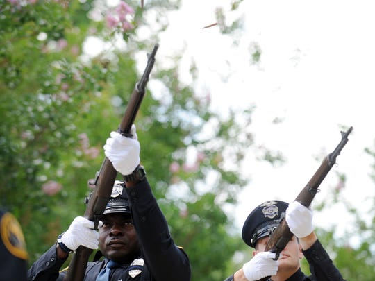 The Hattiesburg Police Honor Guard perform a gun salute