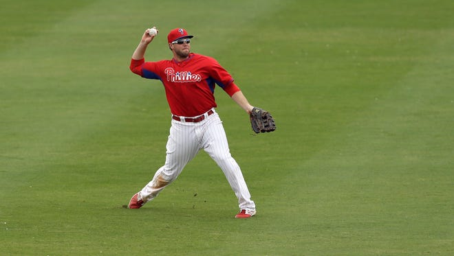 Philadelphia Phillies right fielder Darin Ruf throws to the infield during an exhibition baseball game against the Atlanta Braves Wednesday, March 5, 2014, in Clearwater, Fla. (AP Photo/Charlie Neibergall)