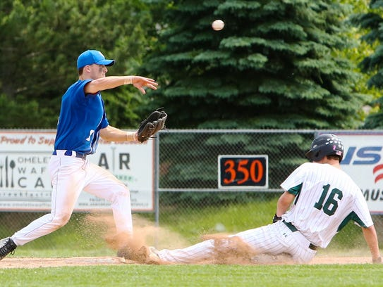 CC's Joey Merucci (left) turns and throws for the attempted