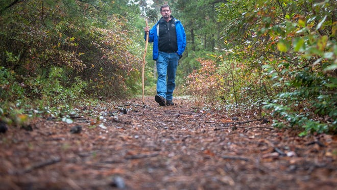 Chris Jage hikes on trails in the Wurst Preserves in Medford that he helped save as a land negotiator for the Ranccoas Conservancy.  10.01.15