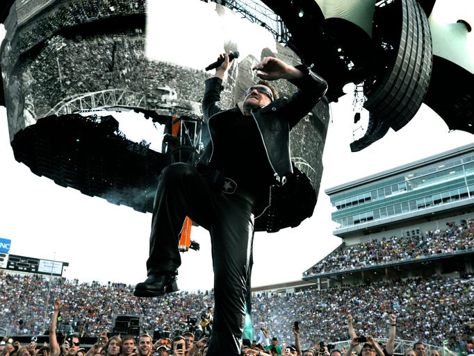 U2's Bono sings for the crowd as the band plays MSU's